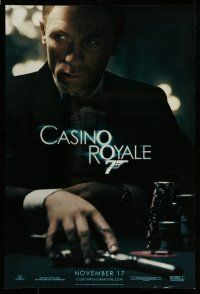 7g120 CASINO ROYALE teaser DS 1sh '06 Daniel Craig as James Bond at poker table with gun!
