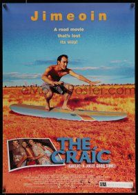 7g153 CRAIC 1sh '99 wacky Alan McKee surfing in field, a road movie that's lost its way!
