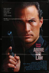 7h025 ABOVE THE LAW 1sh '88 best image of tough guy Steven Seagal!