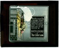 8b004 GRIM GAME glass slide '19 classic image of straitjacketed Harry Houdini hanging off building!