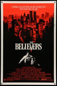 8w067 BELIEVERS 1sh '87 Martin Sheen, Robert Loggia, nothing can stop them, cool image of skyline!