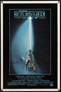 9c019 RETURN OF THE JEDI 1sh '83 George Lucas, art of hands holding lightsaber by Tim Reamer!
