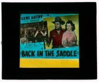 9d040 BACK IN THE SADDLE glass slide '41 singing cowboy Gene Autry with girl & in gambling saloon!