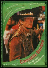 9g449 CROCODILE DUNDEE East German '88 different image of Paul Hogan at New York City bar!