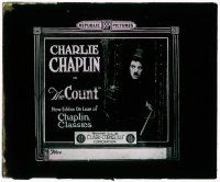 1x023 COUNT glass slide R20s scared Charlie Chaplin holding his cane in front of a door!