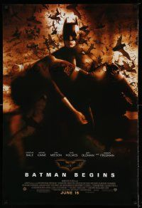 2z075 BATMAN BEGINS June 15 advance DS 1sh '05 Bale carrying Katie Holmes while bats fly!