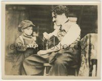6d011 KID 8x10.25 still '21 close up of seated Charlie Chaplin smiling at Jackie Coogan!