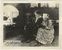 6d009 DOG'S LIFE 8x10 LC '18 c/u of Charlie Chaplin with pipe sitting by Edna Purviance knitting!