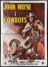 8j045 COWBOYS Italian 2p '72 cool different art of John Wayne with rifle on horseback!