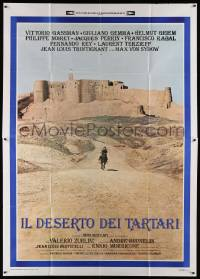 8j050 DESERT OF THE TARTARS Italian 2p '76 cool far shot of soldier riding away from fortress!