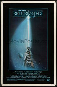 1g009 RETURN OF THE JEDI 1sh '83 George Lucas, art of hands holding lightsaber by Tim Reamer!