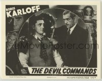 1y036 DEVIL COMMANDS LC R55 close up of Boris Karloff putting man into iron torture device!