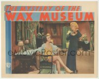 1y020 MYSTERY OF THE WAX MUSEUM LC '33 reporter Glenda Farrell smiles at scantily clad Fay Wray!