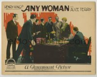 3x533 ANY WOMAN LC '25 men & women standing around desk look at pretty Alice Terry!