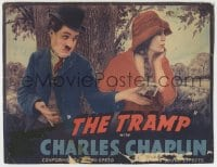 8z033 TRAMP LC R1940 Charlie Chaplin in classic outfit holding out money to uninterested Purviance!
