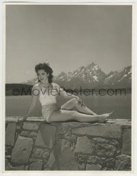 9x009 ANN RUTHERFORD deluxe 10x12.75 still 1940s sitting on rock wall by lake in skimpy swimsuit!