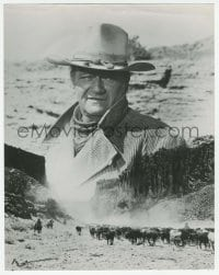 9x038 COWBOYS 10.25x13 still 1972 montage of John Wayne looming over cattle drive across the West!