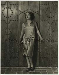 9x167 PAULINE STARKE deluxe 10.5x13.5 still 1929 standing by wonderful riveted door by Russell Ball!