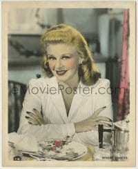 2a061 GINGER ROGERS color deluxe 8x10 still 1939 great smiling c/u with her arms crossed at table!