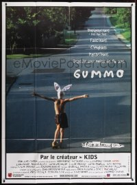 2p823 GUMMO French 1p 1997 wacky image of half-naked man on skateboard & wearing bunny hat!