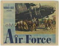 4p026 AIR FORCE LC 1944 Howard Hawks, lots of men pushing airplane in the heat of battle!