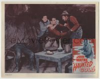 4p393 HAUNTED GOLD LC R1956 c/u of young John Wayne fighting two bad guys in their hideout!