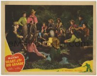 4p399 HEART OF THE RIO GRANDE LC 1942 Gene Autry with lasso smiling at others around campfire!