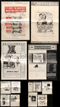 5d264 LOT OF 12 UNCUT PRESSBOOKS 1950s-1970s advertising for a variety of different movies!