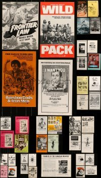 5d244 LOT OF 45 UNCUT PRESSBOOKS 1970s-1980s advertising for a variety of different movies!