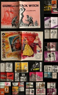 5d246 LOT OF 42 UNCUT PRESSBOOKS 1950s-1970s advertising for a variety of different movies!