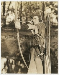 7h055 ADVENTURES OF ROBIN HOOD 7x9 still 1938 great close up of Errol Flynn drawing bow & arrow!
