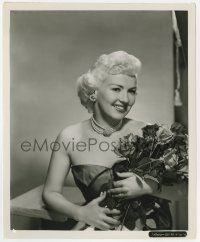 7h131 BETTY GRABLE 8x10 key book still 1950s great smiling close up holding bouquet of roses!
