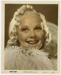7h032 SONJA HENIE color-glos 8x10 still 1930s super close smiling portrait wearing feathers!