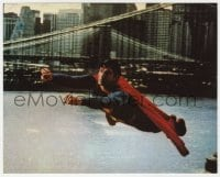7h037 SUPERMAN color 8x10 still 1978 cool fx scene of costumed Christopher Reeve flying by bridge!