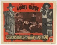 9y753 PICK A STAR LC R1940s Oliver Hardy watches Stan Laurel playing trumpet, Movie Struck!