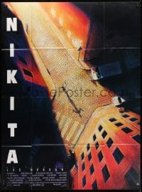 1c719 LA FEMME NIKITA French 1p 1990 Luc Besson, cool overhead art of Anne Parillaud in alley!