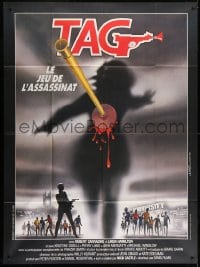1c931 TAG: THE ASSASSINATION GAME French 1p 1983 Landi art of bloody dart hitting silhouette!
