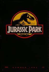1w778 JURASSIC PARK teaser 1sh 1993 Steven Spielberg, classic logo with T-Rex over yellow background