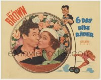 3b343 6 DAY BIKE RIDER LC 1934 close up of Joe E. Brown kissing Maxine Doyle, cool border art!