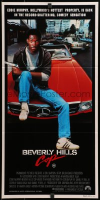 3c240 BEVERLY HILLS COP Aust daybill 1985 great image of cop Eddie Murphy sitting on Mercedes!