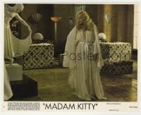 3h046 MADAM KITTY 8x10 mini LC #2 1977 full-length close up of Ingrid Thulin by statue!
