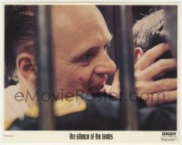 3h058 SILENCE OF THE LAMBS 8x10 mini LC 1991 Anthony Hopkins as Hannibal eating guard's face!