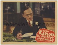 4a678 MYSTERY OF MR WONG LC 1939 close up of Asian detective Boris Karloff examining letter!
