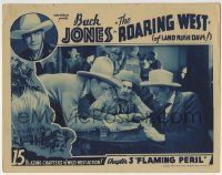 4a774 ROARING WEST chapter 3 LC 1935 cowboy Buck Jones reading map in saloon, Flaming Peril!