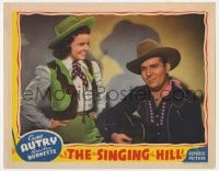 4a821 SINGING HILL LC 1941 Virginia Dale smiles at singing cowboy Gene Autry playing his guitar!