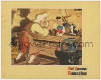 4k293 PINOCCHIO LC 1940 Disney classic cartoon, close up of Gepetto painting the puppet's face!