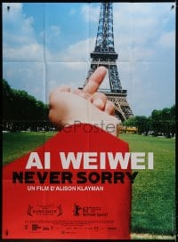 5j049 AI WEIWEI: NEVER SORRY French 1p 2012 great image of middle finger pointed at Eiffel Tower!