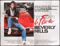5j002 BEVERLY HILLS COP French 8p 1985 great image of cop Eddie Murphy sitting on Mercedes!