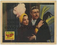5m760 THAT NIGHT IN RIO LC 1941 close up of Don Ameche holding Carmen Miranda in feathered outfit!