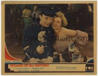 5m814 WOMEN OF ALL NATIONS LC 1931 policeman El Brendel eating by pretty Marjorie White!